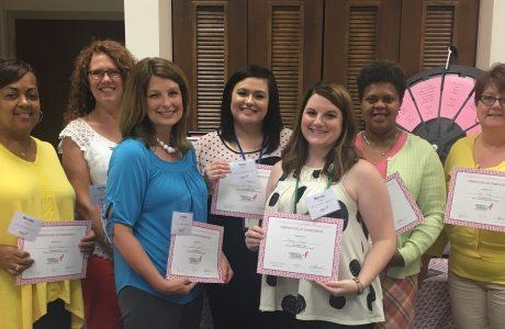 ladies holding certificate