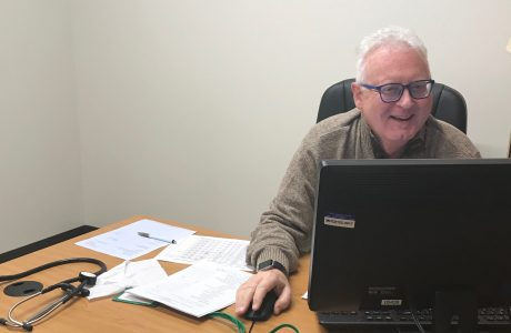 picture of doctor at computer