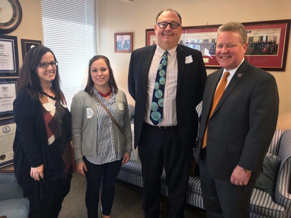 legislator posing with Coalition team members