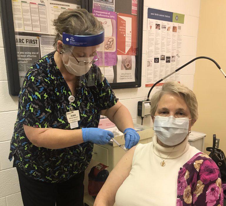 lady receiving vaccine