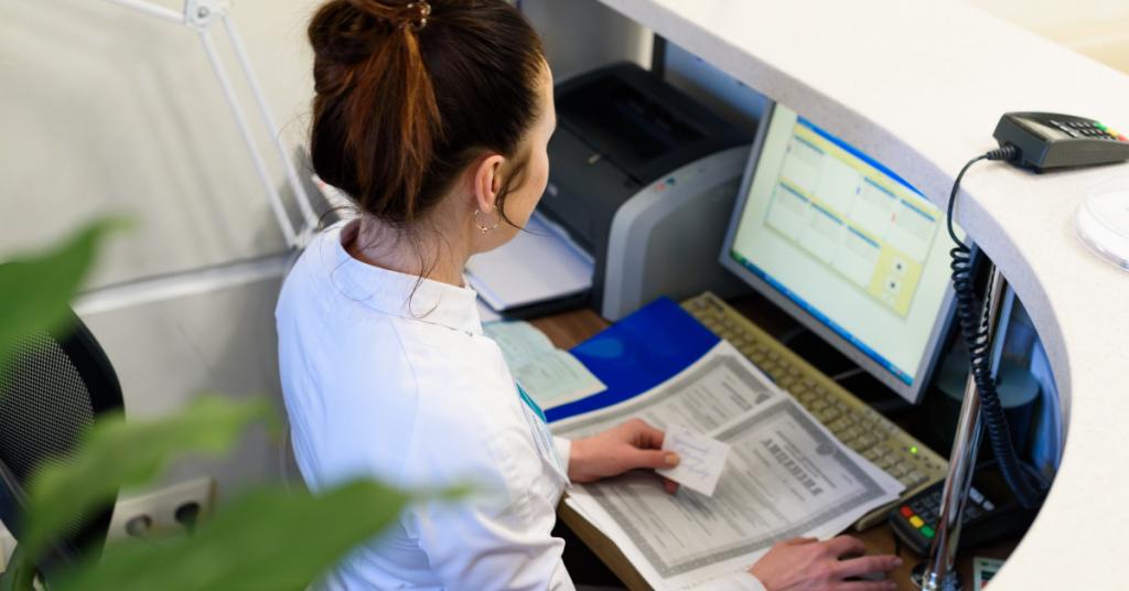 receptionist at computer